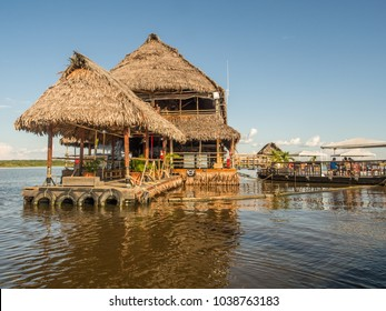 Iquitos, Peru - December 13 2017: Exclusive restaurant on the center of  Amazon River. Al Frio y Al Fuego restaurant.