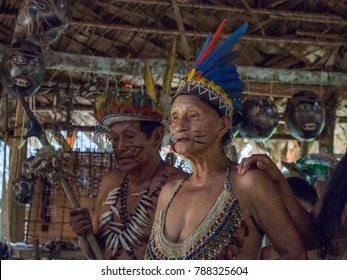 Iquitos, Peru- December 14, 2017: Indian  from Bora tribe in his local costume
