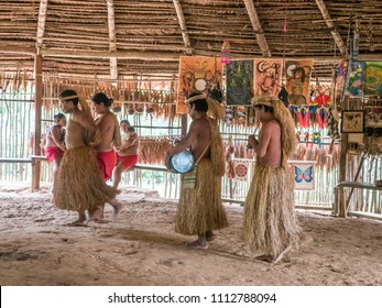 Iquitos, Peru- Mar 28, 2018: Indian from Yagua tribe in his local costume