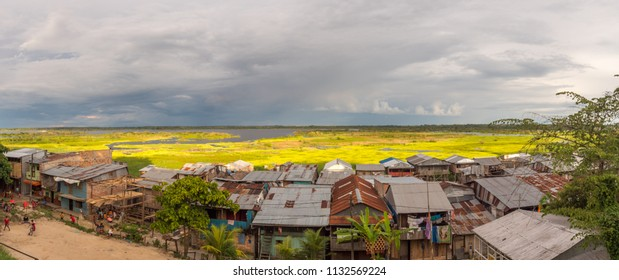 Iquitos, Peru - March 10, 2018: Sunset. Panoramic view of a floating houses and the Itaya river in poor district of Iquitos, Loreto, Peru.  Amazon
