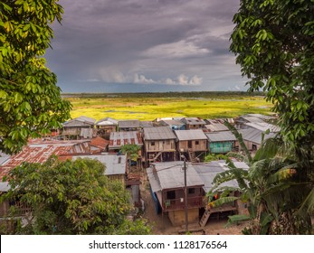 Iquitos, Peru- March 27, 2018: Sunset. View of a floating houses and the Itaya river in poor district of Iquitos, Loreto, Peru.  Amazon