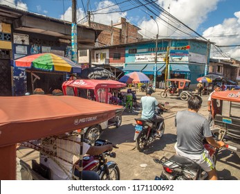 Iquitos, Peru- May 14, 2016: Various rickshaws on a  street of a small town.