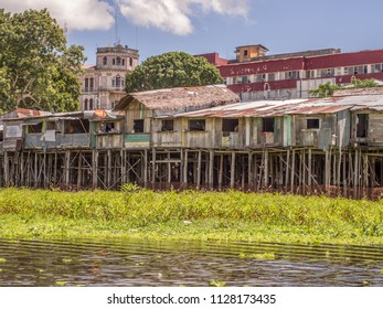Iquitos, Peru- May 15, 2016: Sunset. View of a floating houses and the Itaya river in poor district of Iquitos, Loreto, Peru.  Amazon