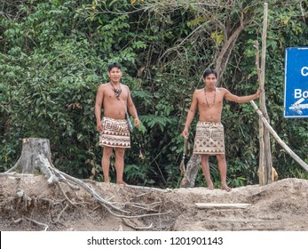 Iquitos, Peru- Sep 26, 2018: Indians from Bora tribe in his local costume