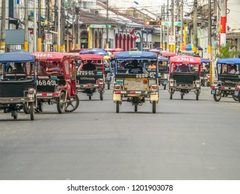 Iquitos, Peru- September 25, 2018: Various rickshaws on a  street of a small town. Latin America.