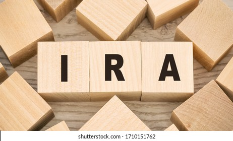 ira individual retirement account inscription on wooden blocks save money concept