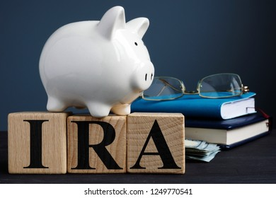 IRA individual retirement account written on wooden cubes.