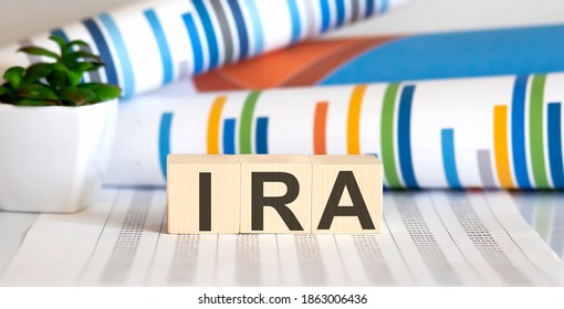 IRA on wooden blocks on the table with different color graphs
