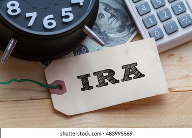 IRA Word on tag with clock,dollar note and calculator,Finance Concept