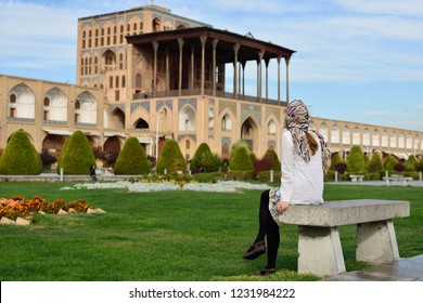 Iran, Ali Qapu Palace  is a grand palace in Isfahan on Naqsh-e Jahan Square in Isfahan (Esfahan). Tourist looking on the palace