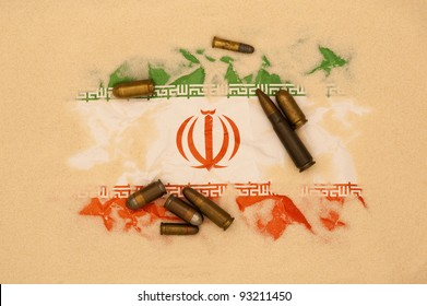 Iran flag covered in sand with different ammunition scatter on it