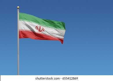 Iran flag in front of a clear blue sky