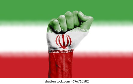 Iran flag painted on a clenched fist. Strength, Power, Protest concept