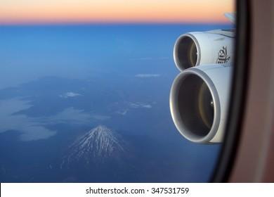 IRAN - JUNE 25, 2014: Emirates Airbus A380 wing view (Damavand volcano seen).