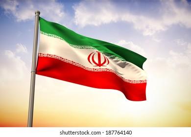 Iran national flag against beautiful orange and blue sky