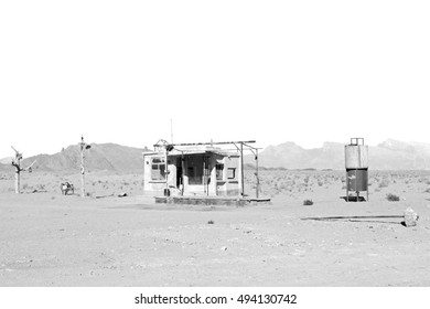 in iran old gas station  the desert mountain background and nobody