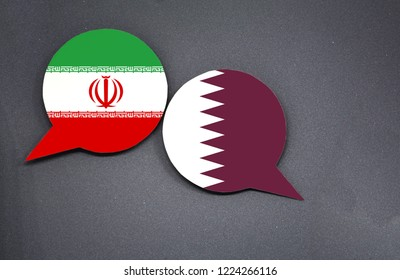 Iran and Qatar flags with two speech bubbles on dark gray background