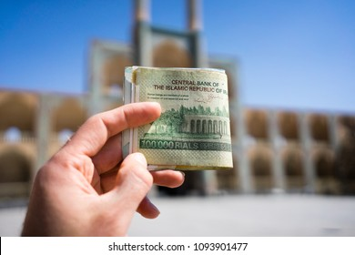 Iran Rial currency banknotes with Iran landmarks in the background