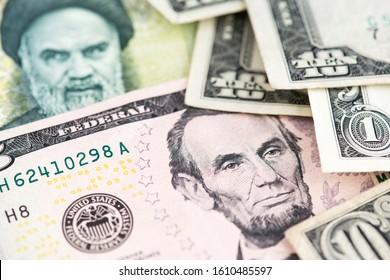 Iran Rial and US Dollar banknotes. USA vs IRAN Crude Oil Price