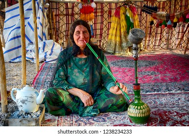 IRAN - SEPTEMBER 7: Qashqai woman at 7 September, 2018 at Iran. The Qasqhai are nomadic people living in temporary villages.