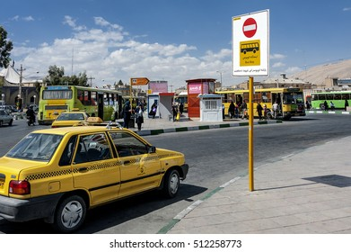 Iran, Shiraz - October 06, 2016: Bus station with yellow taxi in the foreground in the city center.
