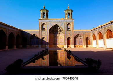 Iran, Shiraz - September 17, 2016: Colorful Mosque Nasir al Mulk in Shiraz. Reflection in water.