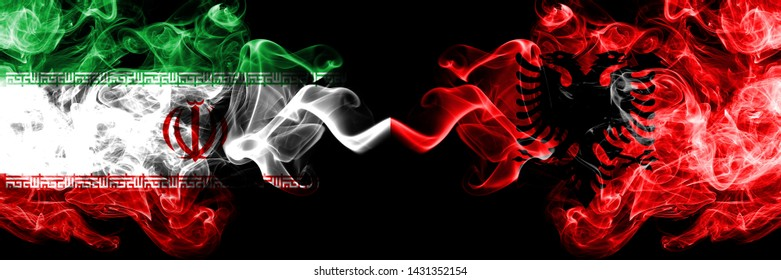 Iran vs Albania, Albanian smoky mystic states flags placed side by side. Thick colored silky smokes flag combination of Iranian and Albania, Albanian