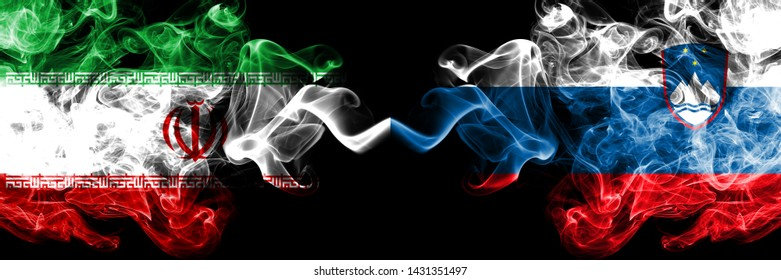 Iran vs Slovenia, Slovenian smoky mystic states flags placed side by side. Thick colored silky smokes flag combination of Iranian and Slovenia, Slovenian