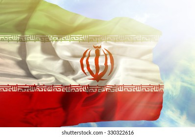Iran waving flag against blue sky with sunrays