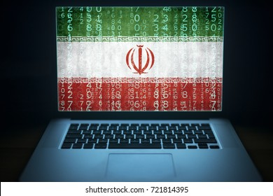 Iranian hacker laptop with binary computer code and Iran flag on the screen. Internet and network security.