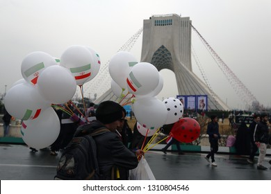 An Iranian man sells balloons at a mass rally marking the 40th anniversary of Islamic Revolution in Tehran's Azadi (Freedom) Square on Feb 11, 2019.