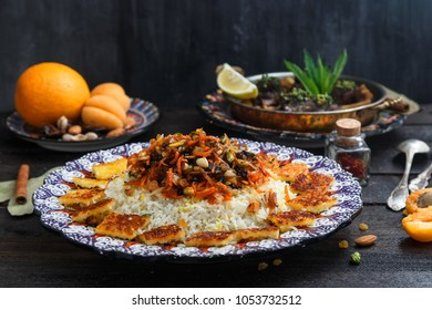Iranian pilaf with orange zest, nuts and raisins, on a traditional plate