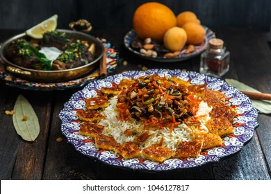 Iranian sweet rice with orange zest, nuts and dried fruits, shirin polo
