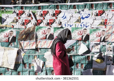 Iran's Parliamentary Election / Tehran , Iran - 21 February 2016 : Persian girl passing by posters of candidates of parliamentary election