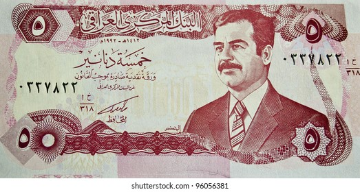 IRAQ - CIRCA 2000 : banknote 5 dinar Iraq , showing the image of deposed leader Saddam Hussain, circa 2000