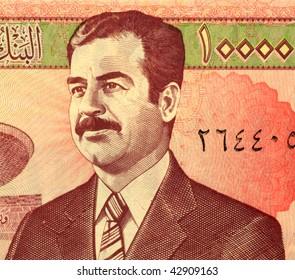 IRAQ - CIRCA UNKNOWN: Saddam Hussein on 10,000 dinars banknote from Iraq.