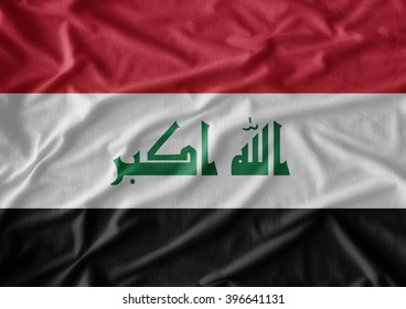 Iraq flag on the fabric texture background