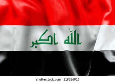 Iraq flag texture creased and crumpled up with light and shadows