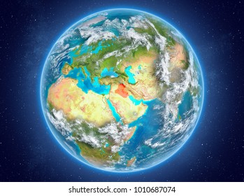 Iraq in red on model of planet Earth with clouds and atmosphere in space. 3D illustration. Elements of this image furnished by NASA.