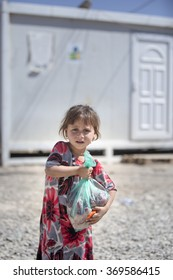 IRAQ / Sulaymaniyah / Arbat Camp 26 June 2015. A girl has taken its share of aid to Syrian refugees.