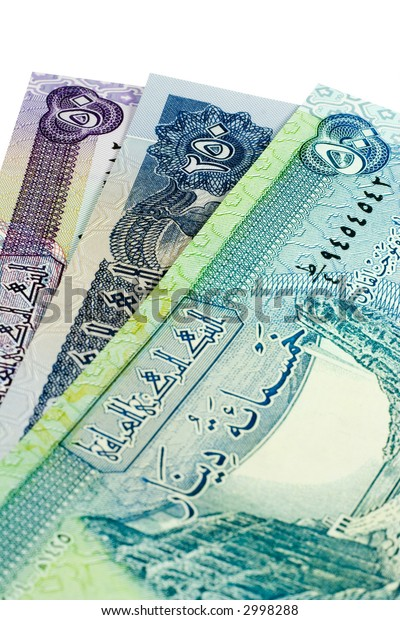 Iraqi banknotes isolated on a white background.