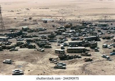 Iraqi Vehicles damaged and abandoned along Highway 80 west of Kuwait City during Operation Desert Storm. Mar. 1 1991.