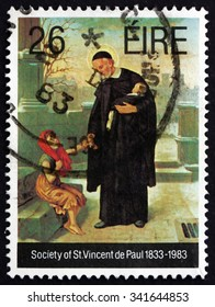 IRELAND - CIRCA 1983: A stamp printed in Ireland shows Priest and Children, Society of St. Vincent de Paul, Sesquicentennial, Catholic Voluntary Organization, circa 1983