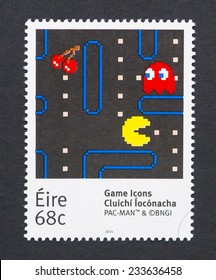 IRELAND - CIRCA 2014: a postage stamp printed in Ireland showing an image of Pac-Man a video game character, circa 2014.