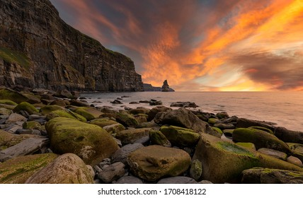 Ireland countryside tourist attraction in County Clare. The Cliffs of Moher and castle Ireland. Epic Irish Landscape UNESCO Global Geopark the wild atlantic way.Beautiful scenic nature Doolin Ireland.