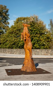 Ireland, County Kerry, Killarney. 18 October 2018. Wood carving of deer. A creative sculpture of a red stag leaping into the air, carved entirely from an existing very old Spanish chestnut tree.