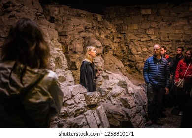 Ireland, Dublin - 18. 09. 2018. Group of tourists having excursion in Dublin Castle exploring medieval excavation of Vikings