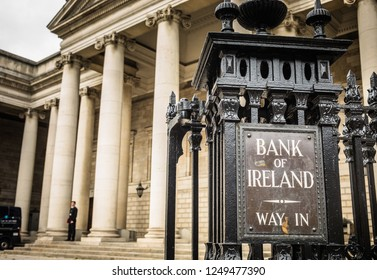 Ireland, Dublin - 19. 09. 2018. Entrance into square of Bank of Ireland with metal board on fence against majestic building