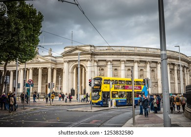 Ireland, Dublin - 19. 09. 2018. Yellow bus and tourist on street with Bank of Ireland in daylight
