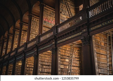 Ireland, Dublin - 19. 09. 2018. From below shot of wooden interior of beautiful Trinity College library with rows of historical books on shelves